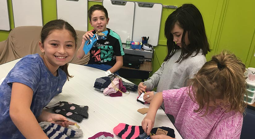 Students sorting socks