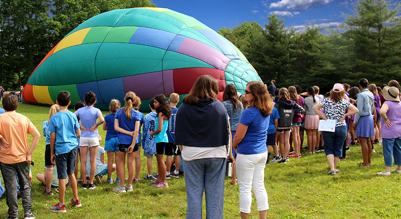 Central School students and staff gather around the hot air balloon as it becomes inflated.