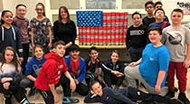 Students next to cans decorated as an American flag.