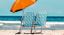 Beach chairs and an umbrella.