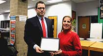 Mary Russo receiving a certificate from board president David Brezee