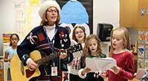 Teacher and students singing Christmas songs.